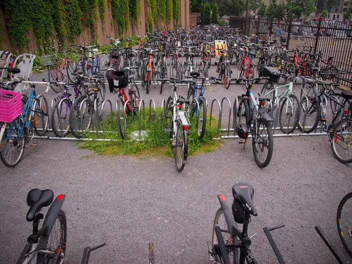 No, this is not a college campus, it's one of the many bicycle parking areas around the Canadian Public Broadcasting building